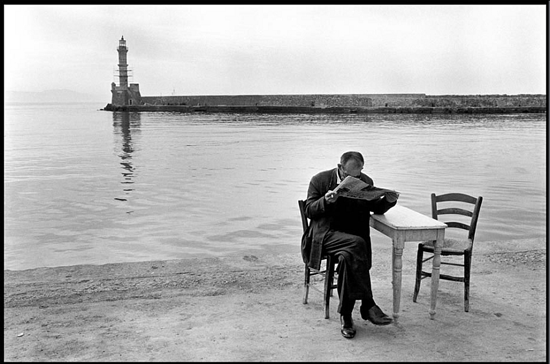 Crete, Chania, 1962. Man reading newspaper | Constantine Manos